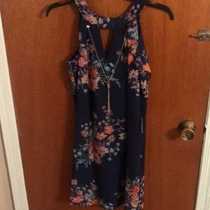 Brand New Beautiful floral dress with tags.